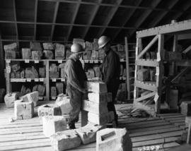 Men working in stone shed