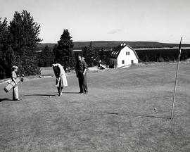 Governor-General Viscount Harold Alexander and Lady Margaret Diana Play Golf
