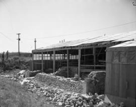 Construction of foundation showing cut stone in corner, facing South