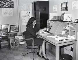 Mary Rideout seated at desk