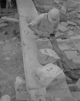 Ned King painting numbers on stones