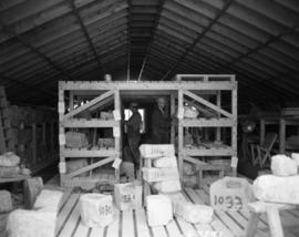 Men working in cut stone shed
