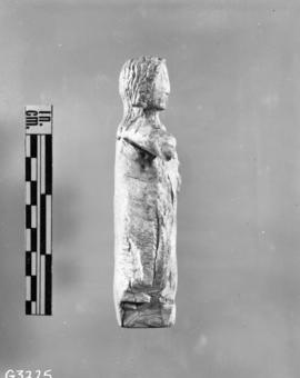 Ivory statuette, right side, extension bellows