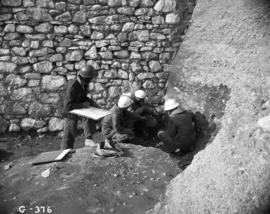 Archaeological staff interpreting stratigraphy, left flank (outside French drain)