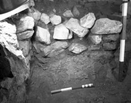 Sq. 32A, wall H, left flank interior revetment footer trench, facing South West
